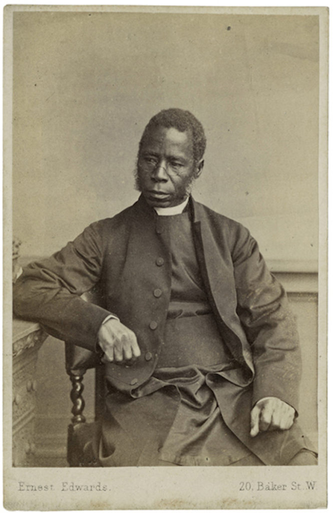 <strong> Bishop Samuel Crowther. London, 1864. Photograph by Ernest Edwards. </strong><br></br>Courtesy of Autograph ABP. Supported by the National Lottery through the Heritage Lottery Fund.<br></br>SAMUEL CROWTHER (c.1807–91) was born to Yoruba parents in Nigeria. Crowther was rescued from slavery by the Royal Navy in 1822 and cared for by missionaries. In London he attended Islington Parish School and later the Church Missionary Society College. He was ordained in 1843 and returned to Africa to preach and teach in Yoruba. A natural linguist, he published a Yoruba dictionary and pioneered studies of other Nigerian languages. In 1851 he visited London for meetings with Queen Victoria, Prince Albert and Lord Palmerston about the anti-missionary ruler of Lagos. In 1864 he was consecrated bishop and presided over an all-African clergy in the Niger mission.<br></br>Albumen carte-de-visite,  64x100mm.