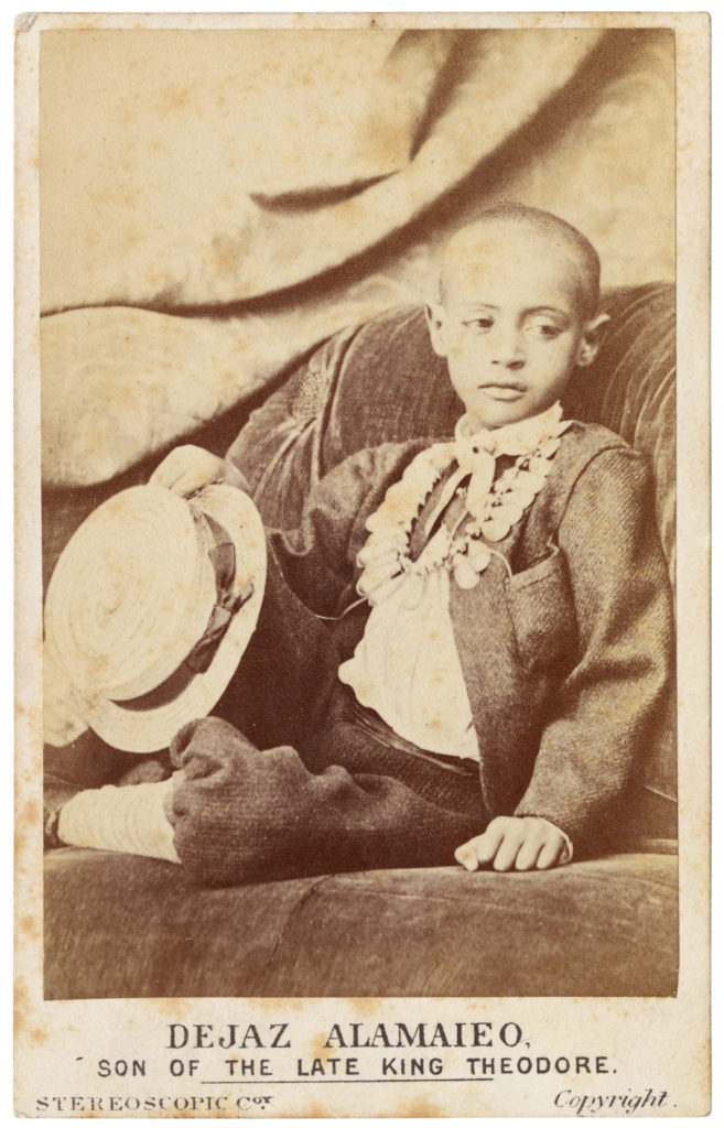 <strong>Prince Alamayou. Ryde, Isles of Wight. 1868. Photograph by Jabez Hughes. </strong><br></br>Courtesy of Autograph ABP. Supported by the National Lottery through the Heritage Lottery Fund.<br></br> PRINCE ALAMAYOU (1861–79) was the son of Emperor Tewodros II of modern-day Ethiopia (then Abysinia), who committed suicide following his capture by the British during the Battle of Magdala in 1868. The young Prince Alamayou was brought to Britain in the care of Tristram Charles Sawyer Speedy (1836–1910), an army officer and explorer. Alamayou lived with Speedy on the Isle of Wight and was presented to Queen Victoria, who is said to have been very fond of him and wrote about their encounters in her diary journals. He was educated at Cheltenham College, Rugby School, and at the Royal Military College, Sandhurst but died of pleurisy aged just eighteen. At the queen's request, he was buried in St George's Chapel, Windsor.  <br></br>Albumen carte-de-visite,  64x100mm.