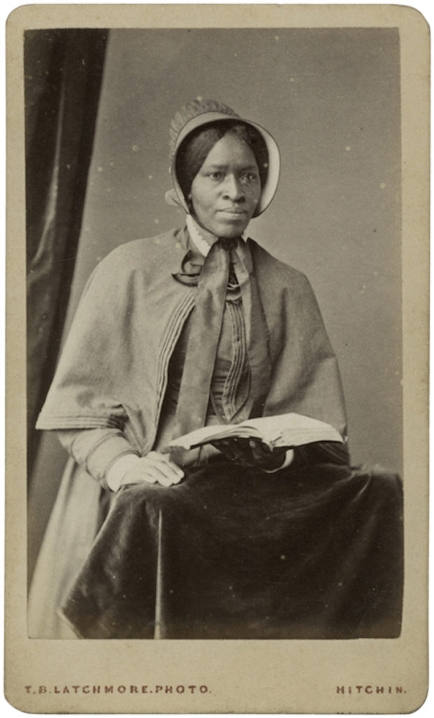 <strong> Amanda Smith. Circa 1876-1877. Photograph by T.B. Latchmore. </strong><br></br>Courtesy of Autograph ABP. Supported by the National Lottery through the Heritage Lottery Fund.<br></br>Amanda Smith (1837-1915) was a former African American slave turned Quaker evangelist and missionary. She travelled extensively throughout the world and upon her return from Africa, she opened the Amanda Smith Orphanage and Industrial Home for Abandoned and Destitute Colored Children. Located in North Harvey, in a suburban neighborhood in Chicago, the orphanage opened on June 28, 1899.      In 1876/78 she was invited to speak in England and  Scotland where she stayed for eighteen months. Her autobiography was published in 1893, titled 'An Autobiography, The Story of the Lord's Dealing with Mrs. Amanda Smith, the Colored Evangelist Containing an Account of her Life Work of Faith, and Her Travels in America, England, Ireland, Scotland, India, and Africa, as An Independent Missionary'.<br></br>Albumen carte-de-visite,  64x100mm.