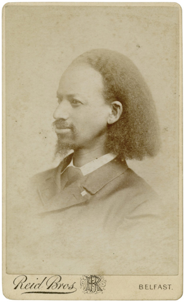<strong> Reverend Thomas Johnson. Belfast, 1877. Photograph by Reid Bros. </strong><br></br>Courtesy of Autograph ABP. Supported by the National Lottery through the Heritage Lottery Fund.<br></br>Thomas Johnson (1836-1921), American Baptist minister and missionary born into slavery who came to London in 1876 as a beneficiary of the YMCA in Manchester and the Baptist Missionary Society in London. He published his autobiography 'Twenty-Eight Years a Slave, or The Story of My Life in Three Continents' in 1882. Became a British subject in 1900.<br></br>Albumen carte-de-visite,  64x100mm.