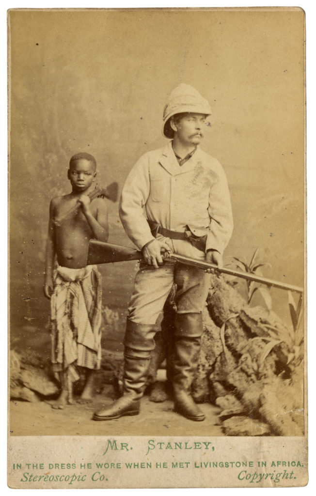<strong> Kalulu, with Henry Morton Stanley. London, 1872. Photograph by The London Stereoscopic Company. </strong><br></br>Courtesy of Autograph ABP. Supported by the National Lottery through the Heritage Lottery Fund.<br></br>Ndugu M'Hali (c.1865–77), known as Kalulu, was the personal servant and companion to explorer Sir Henry Morton Stanley. Named Kalulu by Stanley, he was educated in London and accompanied Stanley on his travels to Europe, America and the Seychelles. He died tragically during an expedition in 1877 in the Lualaba River, the headstream of the River Congo. Stanley later renamed these rapids 'Kalulu Falls' in his memory.     Carte-de-visite is inscribed 'Mr Stanley - In The Dress He Wore When He Met Livingstone In Africa', failing to name or mention Kalulu.<br></br>Albumen carte-de-visite,  64x100mm.