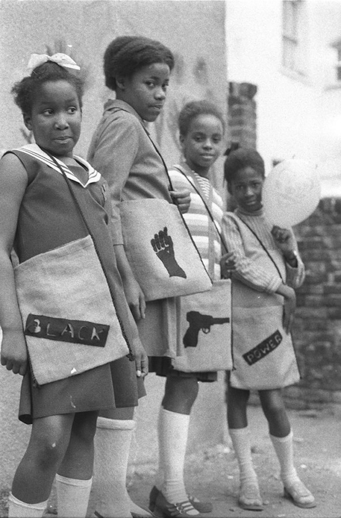 "Black Panther school bags, London, 1972. Fibre-based silver gelatin print, 12 x 16""© Neil Kenlock / Courtesy of Autograph ABP, London. Supported by the National Lottery through the Heritage Lottery Fund."