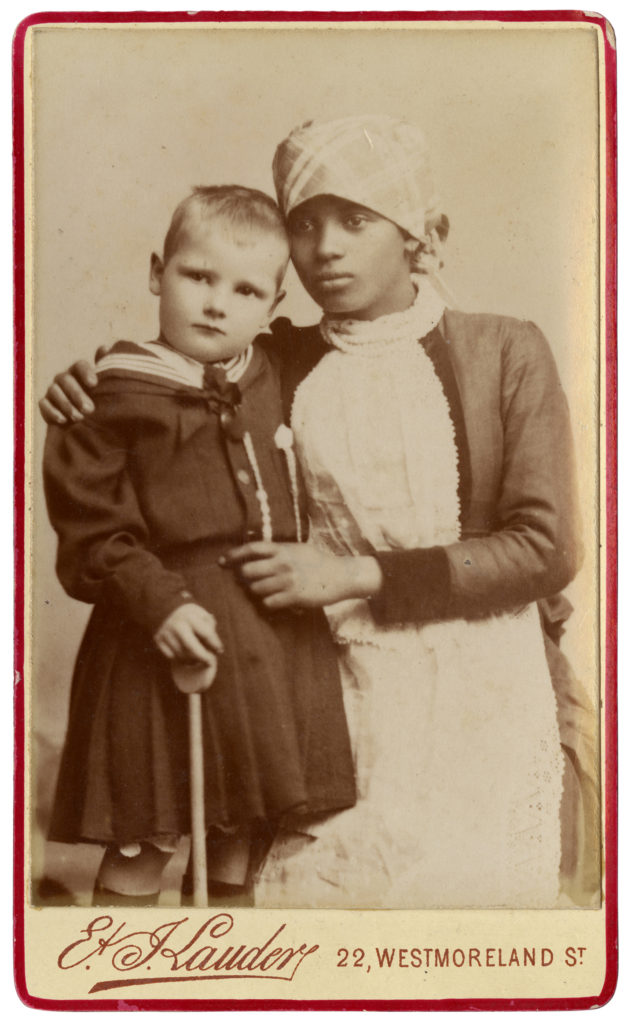<strong> Unidentified Ayah, with child. Dublin, 1890s (?). Photograph by E&J Lauder. </strong><br></br>Courtesy of Autograph ABP. Supported by the National Lottery through the Heritage Lottery Fund.<br></br>An ayah was a nursemaid or nanny employed by Europeans in India or other former British territories.  Unfortunately no further details are currently known about this sitter, or the child pictured with her. <br></br>Albumen carte-de-visite,  64x100mm.