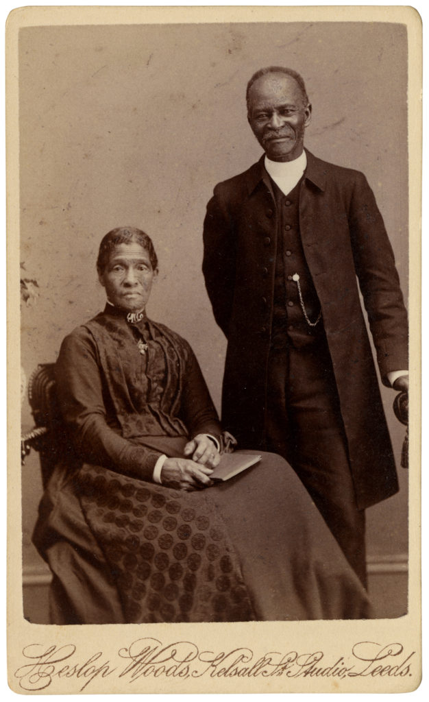 <strong> The Bishop Walter Hawkins and his Wife (?).  Leeds, date unknown - circa 1890s. Photograph by Heslop Woods, Kelsall St Studio. </strong><br></br>Courtesy of Autograph ABP. Supported by the National Lottery through the Heritage Lottery Fund.<br></br>Bishop Walter Hawkins of the British Methodist Episcopal Church Canada. Walter Hawkins was born (b. 1809?  )a slave in Georgetown, Maryland. After being sold to a slave-dealer, Hawkins escaped to Philadelphia. He later moved on to Canada where he became a Methodist minister. In 1890 Hawkins was made a bishop Methodist Episcopal Church. With help from Celestine Edwards, Hawkins wrote his autobiography, From Slavery to Bishopric', first published in 1891.<br></br>Albumen carte-de-visite,  64x100mm.