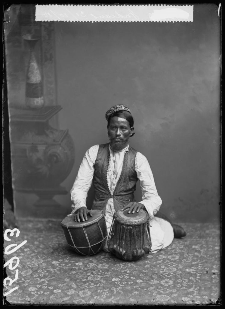 <strong>Unidentified Sitter. London, 1885. <br>By the London Stereoscopic Company.   </strong>   <br></br>  © Hulton Archive/Getty Images. Courtesy of Hulton Archive, and Autograph ABP, London. Supported by the National Lottery through the Heritage Lottery Fund. <br></br>  Portrait of a musican photographed at the London Stereoscopic Company studio on 31 October 1885. He was part of an Indian musical troupe who performed in variety entertainment during the Victorian era. No further details about the group and its members are known at this stage.<br></br>  Fibre-based silver gelatin print, 20x24""