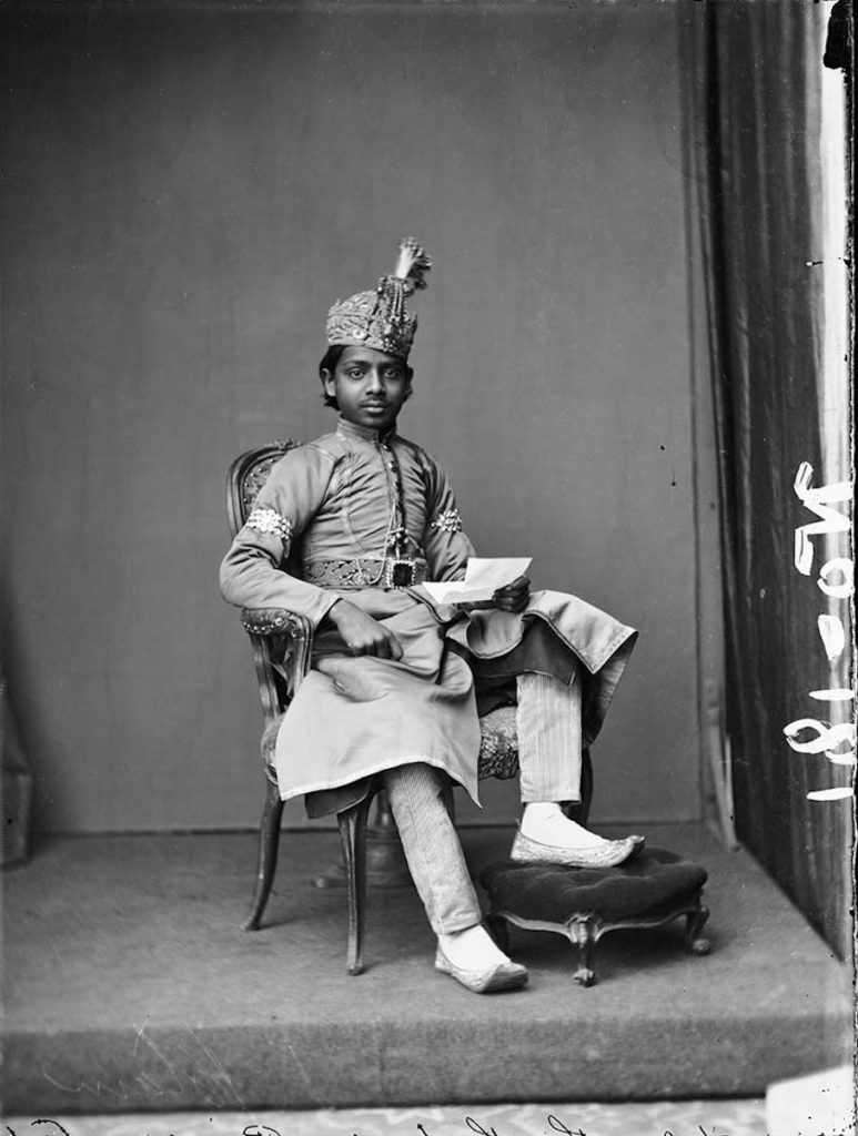<strong>Unidentified sitter. London, circa 1890.   <br>By London Stereoscopic Company.</strong>   <br></br>  © Hulton Archive/Getty Images. Courtesy of Hulton Archive, and Autograph ABP, London. Supported by the National Lottery through the Heritage Lottery Fund. <br></br>  This young man is presumed to belong to a ruling royal family of one of the princely states of British colonial India. No further details are known at this stage. <br></br>  Fibre-based silver gelatin print, 20x24""