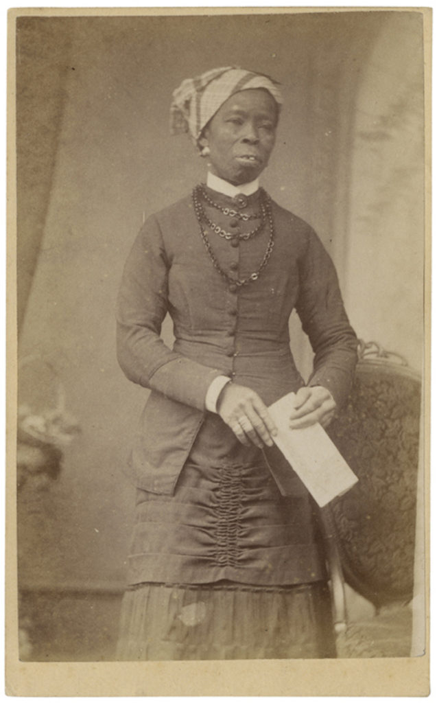 <strong> 'Chief Zula's sister'. London, circa 1880. Photograph by Rev. R. W. Odell. </strong><br></br>Courtesy of Autograph ABP. Supported by the National Lottery through the Heritage Lottery Fund.<br></br>No further details are known about the sitter's identity. Inscription verso reads Chief Zula's sister.<br></br>Albumen carte-de-visite,  64x100mm.