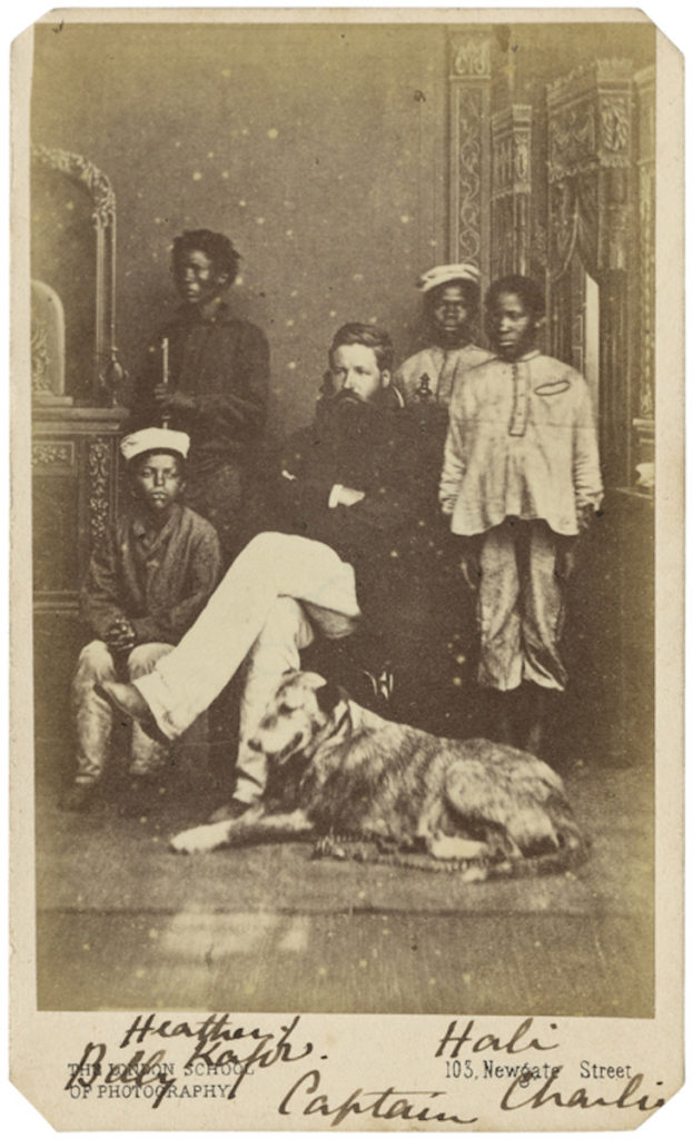 <strong> Heathen, Kafir Hali, Charlie, Billy and Captain (dog?). Newcombe, circa 1868.  Photograph by The London School of Photography/Mr. S. Prout.</strong><br></br>Courtesy of Autograph ABP. Supported by the National Lottery through the Heritage Lottery Fund.<br></br>No further details are known about the sitters' identities.  They may have been crew members on Mr & Mrs Robertson's missionary voyage to Zululand. <br></br>Albumen carte-de-visite,  64x100mm.