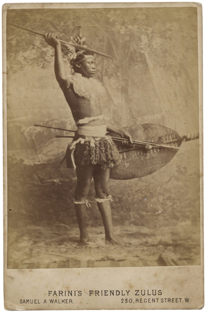 <strong> Farini's Friendly Zulu. London, 1879. Phgotograph by Samuel A. Walker. </strong><br></br>Courtesy of Autograph ABP. Supported by the National Lottery through the Heritage Lottery Fund.<br></br>This unknown sitter was likely brought to Britain with a Zulu troupe during the Anglo-Zulu War of 1879, performing as part of explorer Guillermo Antonio Farini's Friendly Zulus.<br></br>Albumen cabinet card, 105x162mm