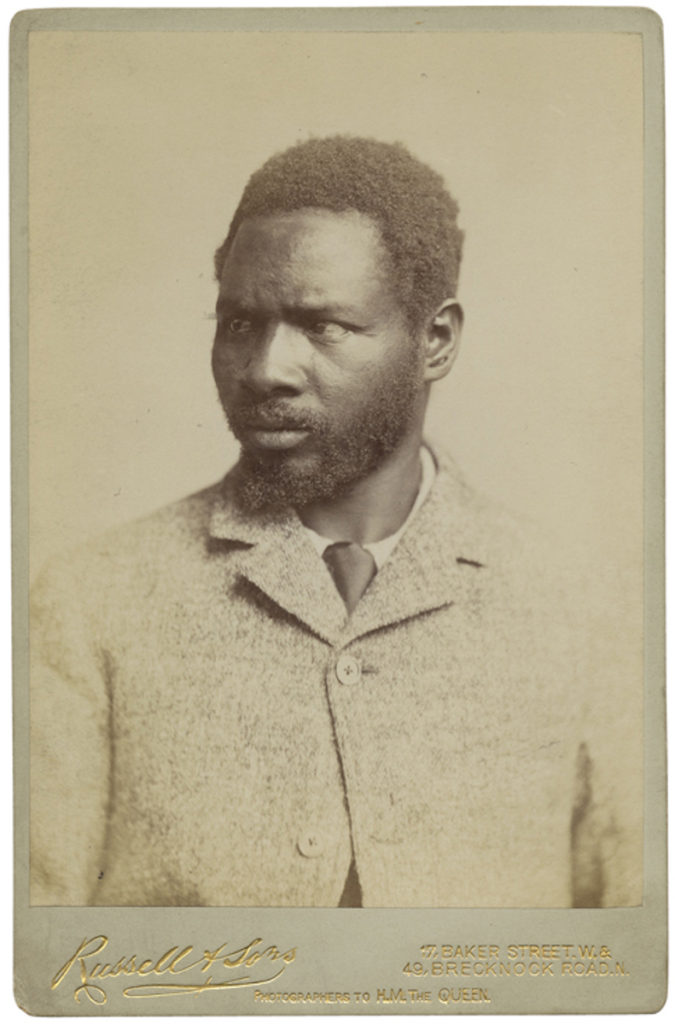 <strong> Umfeti Interni. London, 1891. Photograph by Russell & Sons. </strong><br></br>Courtesy of Autograph ABP. Supported by the National Lottery through the Heritage Lottery Fund.<br></br>Umfeti Interni one of two envoys of King Gungunhana of Gazaland to Queen Victoria, sent to settle a colonial land dispute on the lower Zambesi between Britain and Portugal. No further details are known about the sitter's identity.  No further details are known about the sitter's identity.                               <br></br>Cabinet card, 108x164mm