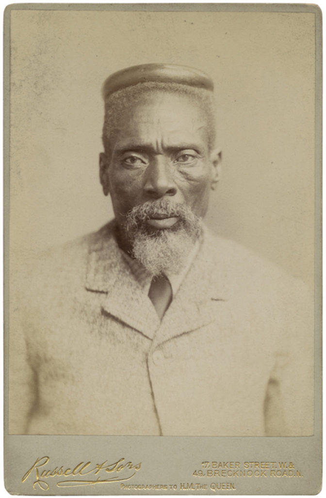 <strong> Huluhulu Umteto. London, 1891. Photograph by Russell & Sons. </strong><br></br>Courtesy of Autograph ABP. Supported by the National Lottery through the Heritage Lottery Fund.<br></br>Huluhulu Umteto, one of two envoys of King Gungunhana of Gazaland to Queen Victoria, sent to settle a colonial land dispute on the lower Zambesi between Britain and Portugal.  No further details are known about the sitter's identity.                                  <br></br>Cabinet card, 108x164mm
