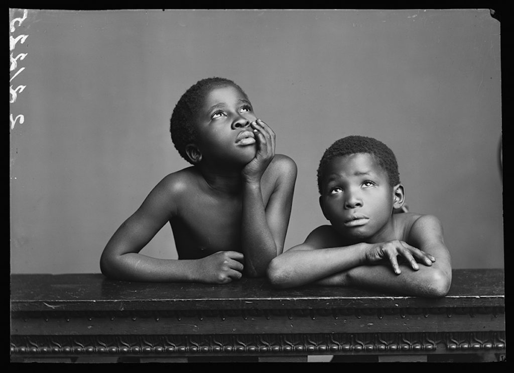 <strong>Albert Jonas and John Xiniwe, The African Choir. London, 1891. By London Stereoscopic Company.</strong> <br></br>  © Hulton Archive/Getty Images. Courtesy of Hulton Archive, and Autograph ABP, London. Supported by the National Lottery through the Heritage Lottery Fund.  <br></br> Fibre-based silver gelatin print, 20x24""