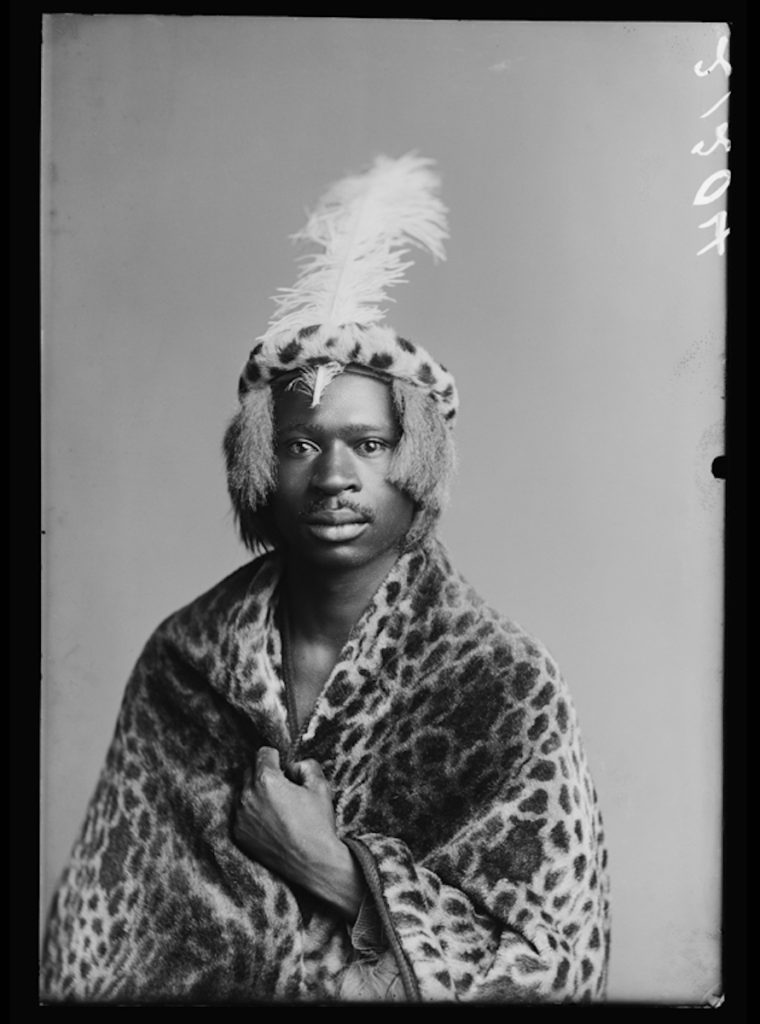 <strong>Josiah Semouse, The African Choir. London, 1891. <br>By the London Stereoscopic Company.   </strong>   <br></br>  © Hulton Archive/Getty Images. Courtesy of Hulton Archive, and Autograph ABP, London. Supported by the National Lottery through the Heritage Lottery Fund. <br></br>  Josiah Semouse was a South African writer who travelled to England in 1891 as a member of the African Choir. During the choir's tour, Semouse kept a journal which was later published in his native Sesotho language in the missionary press - possibly the first example of indigenous writing about the empire's metropolis in an African language. Queen Victoria addressed Semouse directly during the choir's command performance at Osborne House, enquiring about his experience fighting against the British during the Basutu war ten years prior.                    <br></br>  Fibre-based silver gelatin print, 20x24""