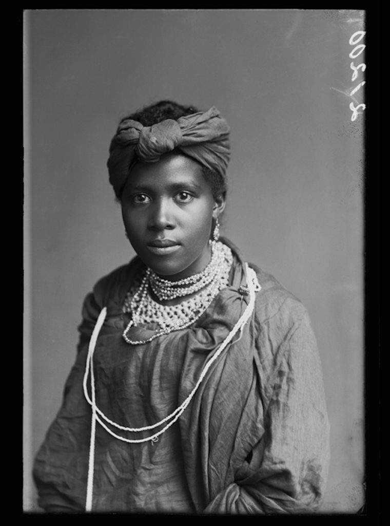 <strong>Saanie Koopman, The African Choir. London, 1891. <br>By the London Stereoscopic Company.   </strong>   <br></br>  © Hulton Archive/Getty Images. Courtesy of Hulton Archive, and Autograph ABP, London. Supported by the National Lottery through the Heritage Lottery Fund. <br></br>  Saanie Koopman was a member of The African Choir, who toured Britain between 1891 and 1893 to raise funds to build a technical college on the Cape Coast, performing to great acclaim and large audiences at Crystal Palace, for members of the British aristocracy and leading political figures, and most notably for Queen Victoria at Osborne House, Isle of Wight.  Their stage repertoire was divided into two halves: one comprised Christian hymns sung in English together with popular operatic arias and choruses; the other traditional African hymns. The choir appeared in traditional African dress, and in contemporary Victorian dress in response. Little else is currently known about her life.                     <br></br>  Fibre-based silver gelatin print, 20x24""
