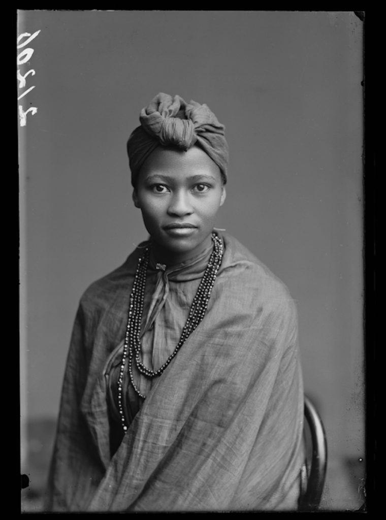 <strong>Frances Gqoba, The African Choir. London, 1891. <br>By London Stereoscopic Company.</strong>   <br></br>  © Hulton Archive/Getty Images. Courtesy of Hulton Archive, and Autograph ABP, London. Supported by the National Lottery through the Heritage Lottery Fund. <br></br>  Frances Gqoba was a member of The African Choir, who toured Britain between 1891 and 1893 to raise funds to build a technical college on the Cape Coast, performing to great acclaim and large audiences at Crystal Palace, for members of the British aristocracy and leading political figures, and most notably for Queen Victoria at Osborne House, Isle of Wight.  Their stage repertoire was divided into two halves: one comprised Christian hymns sung in English together with popular operatic arias and choruses; the other traditional African hymns. The choir appeared in traditional African dress, and in contemporary Victorian dress in response. Little else is currently known about her life.     <br></br>  Fibre-based silver gelatin print, 20x24""