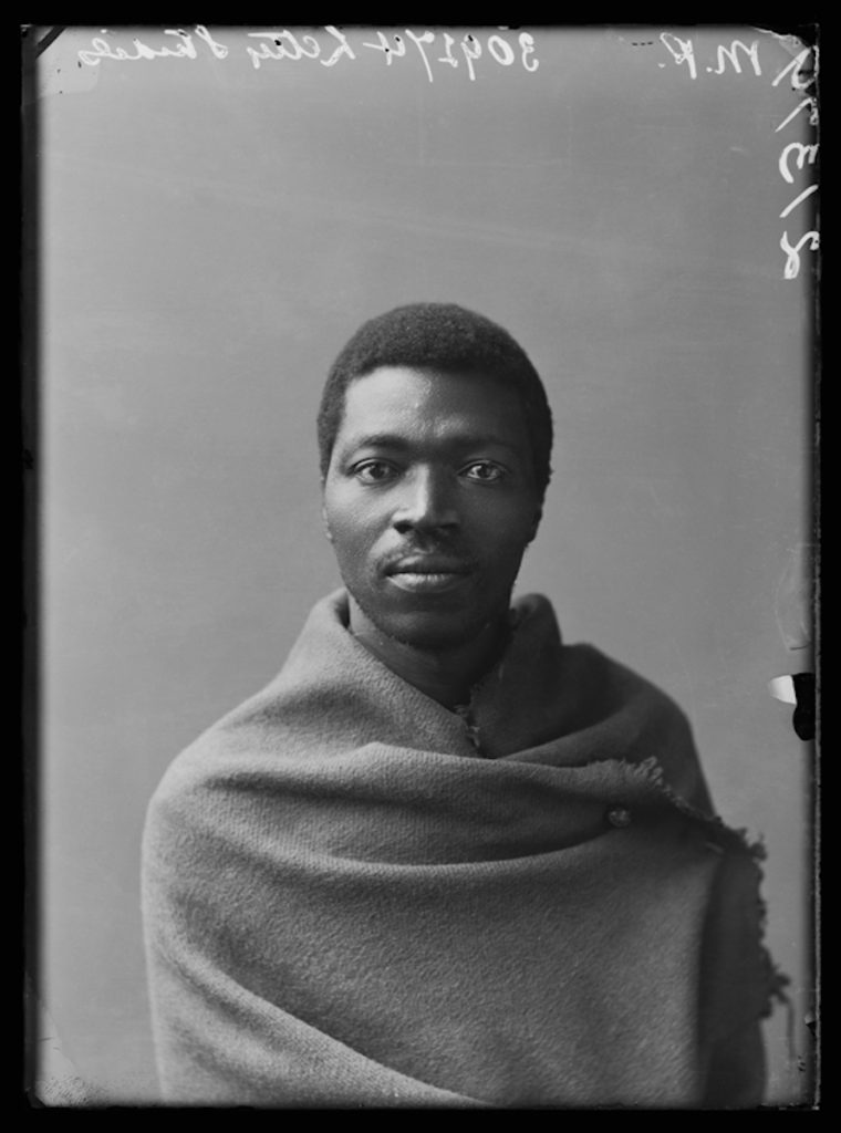 <strong>Paul Xiniwe, The African Choir. London, 1891 <br>By the London Stereoscopic Company.   </strong>   <br></br>  © Hulton Archive/Getty Images. Courtesy of Hulton Archive, and Autograph ABP, London. Supported by the National Lottery through the Heritage Lottery Fund. <br></br>  Paul Xiniwe (1857–1902) of the African Choir was a social entrepreneur and political leader. A graduate of Lovedale College, he trained as a teacher and later become a leading figure of the South African Native Congress (which in 1912 became the African National Congress, and was instrumental in paving the way for the post-Apartheid state). Together with his wife Eleanor Xiniwe, née Ndwanya, he opened the Temperance Hotel - the first hotel for black Africans - in 1894 in King Williams Town in the Cape Province. The couple had five children and were one of the most established families in the Cape, part of an educated social group actively engaged in national politics, and social change. <br></br>  Fibre-based silver gelatin print, 20x24""