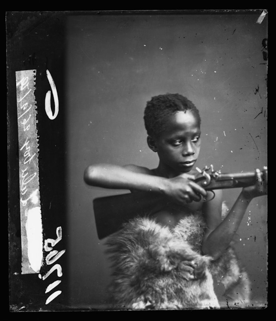 <strong>Unidentified Sitter 'Zulu Boy'. London, 1879. <br>By the London Stereoscopic Company.   </strong>   <br></br>  © Hulton Archive/Getty Images. Courtesy of Hulton Archive, and Autograph ABP, London. Supported by the National Lottery through the Heritage Lottery Fund. <br></br>  Nicknamed 'Zulu Boy', this young man was brought to England during the Anglo- Zulu war by British soldiers of the 13th regiment. He arrived on the HMS Euphrates troopship in Devonport, a district of Plymouth in the English county of Devon, on 18 September 1879 - eight days before his portrait was taken at the London Stereoscopic Company studios. While the press reported extensively on his arrival, no further details are known about his life in England, or whether he returned to his native Zululand, South Africa. His portrait also bears the inscription 'Samba Klaas' in the LSC portrait album (no further details known). <br></br>  Fibre-based silver gelatin print, 20x24""